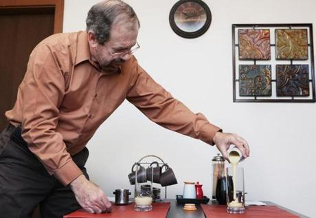 Len Brault leads coffee tastings in a Medford warehouse.